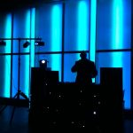 disco rig silhouetted on blue lights background