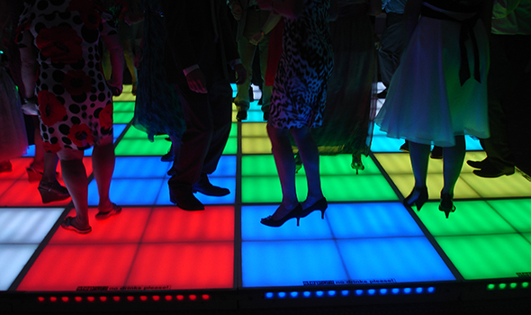 Leds and feet dancing on a multicolored LED dancefloor