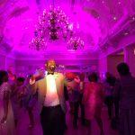 man dnacing in purple light